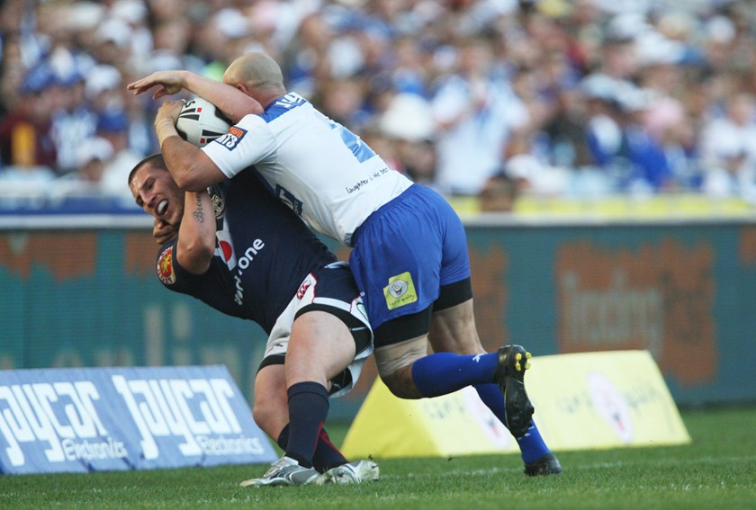 El Masri forces Warrior Lewis Brown into touch.